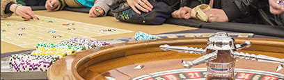Roulette players at a casino table